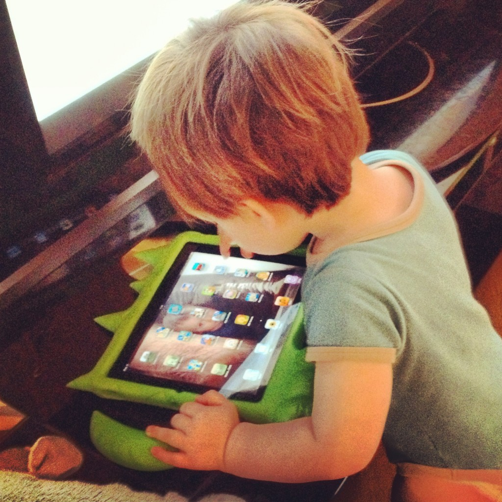 Roo at about 20 months old playing with 'his' iPad!