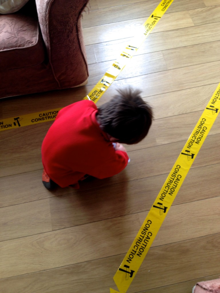 Construction tape along the floor went down a treat! Really easy to buy from somewhere like eBay, and not at all pricey!