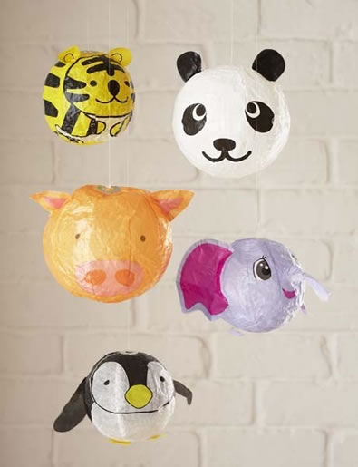 These balloons are such a cute decorations. To hang them put a match stick with the head broken off in the top of the balloon and wrap your twine around it. Hang from the ceiling, and away you go!