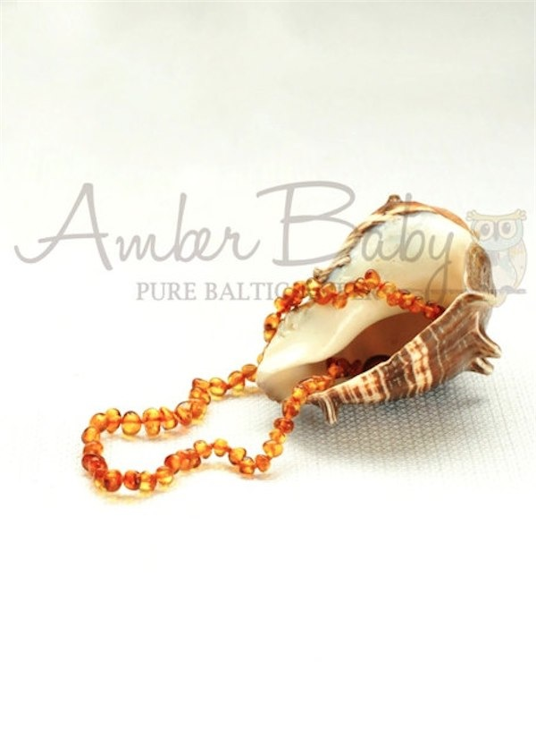 Amber teething jewellery via Toby & Roo :: daily inspiration for stylish parents and their kids.