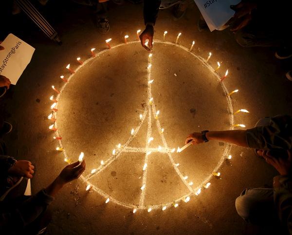 People light candles during a vigil in Kathmandu November 15, 2015, following the deadly attacks in Paris. REUTERS/Navesh Chitrakar - RTS75NH