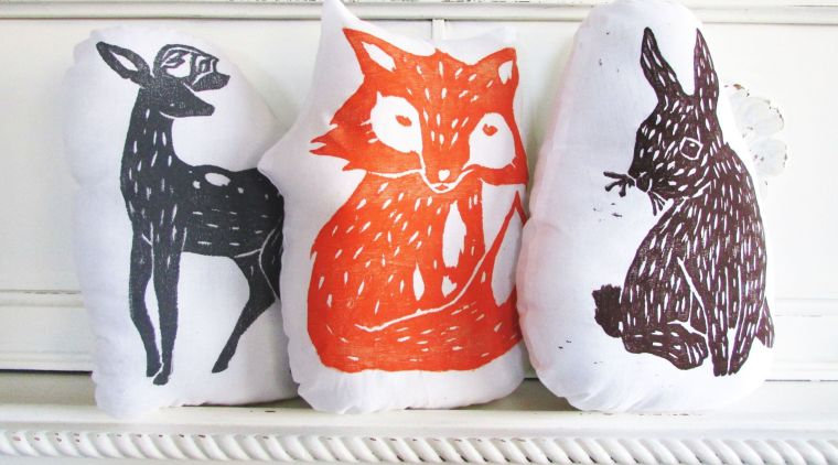Natural cotton pillows that have been hand wood block printed.