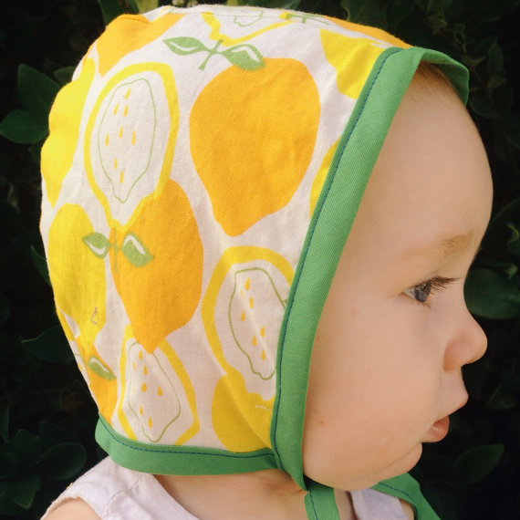 Adorable baby bonnets from Stella & Wilbur via Toby & Roo :: daily inspiration for stylish parents and their kids.